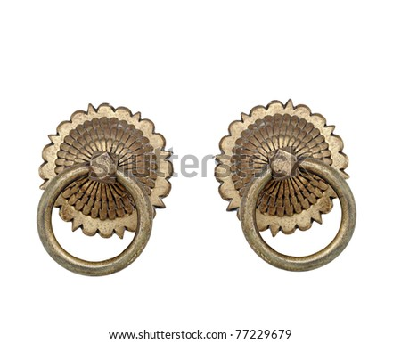 Exotic ornamental brass door knocker isolated against white background. - stock photo