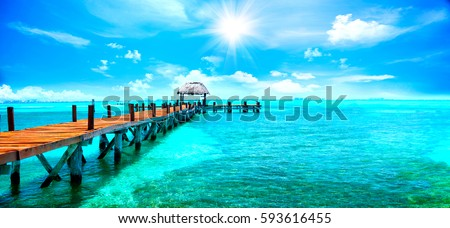 Exotic Paradise. Travel, Tourism and Vacations Concept. Tropical Resort. Caribbean sea Jetty near Cancun, Mexico