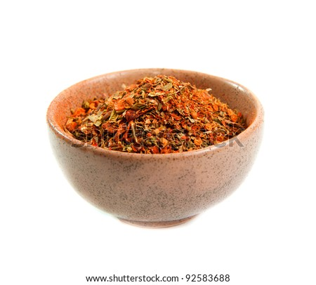 exotic spices in a ceramic bowl isolated on white - stock photo