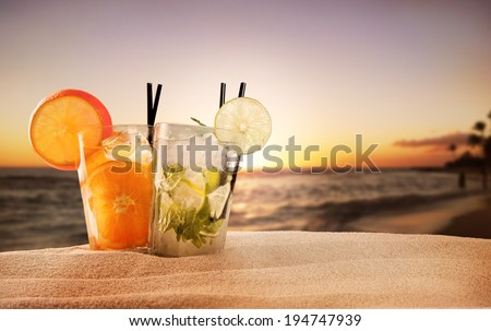 Exotic summer drinks , blur sandy beach on background - stock photo