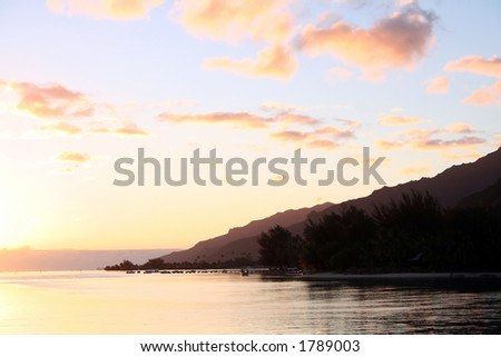 Exotic sunrise in Tahiti - stock photo
