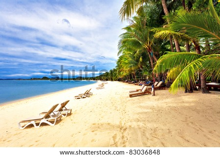 Exotic tropical beach under blue sky. Thailand - stock photo