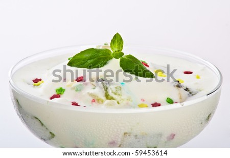 exotic vanilla ice cream with fruits and small star shaped candies served in margarita glass