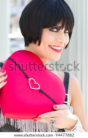 Exotic Woman holding a heart