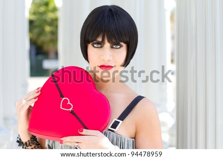 Exotic Woman holding a heart - stock photo