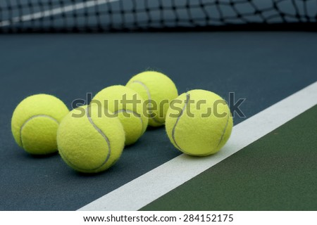 exotic yellow color tennis ball  on court  background