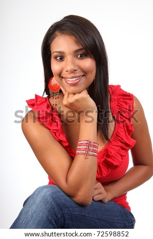 Exotic young girl relaxing and smiling - stock photo
