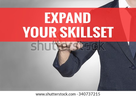 Expand Your Skillset word Business man touching on red tab virtual screen for business concept - stock photo