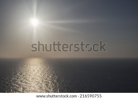 Expanse of the sea against the sunset sky. Beautiful seascape. Horizontal landscape view with place to write text - stock photo