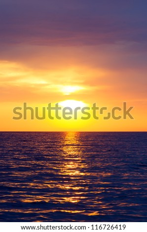 Expanse of the sea against the sunset sky. Beautiful seascape. Natural composition. - stock photo