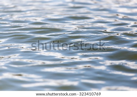expanse of water in the lake as a backdrop - stock photo