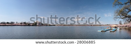 Expansive panorama of the Tidal Basin in Washington DC with the Jefferson Memorial in the foreground - stock photo