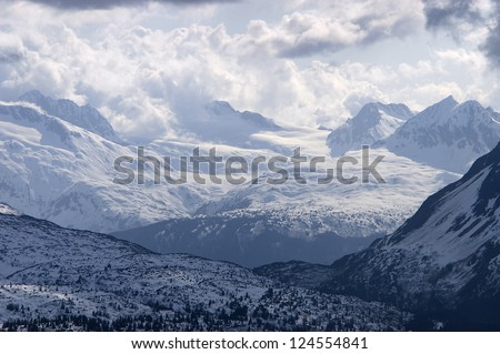 Expansive View of an Alaskan Mountain Range, hard to tell difference between cloud and mountain