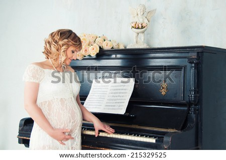 Expectant mother in anticipation of birth of baby. Music of Heart