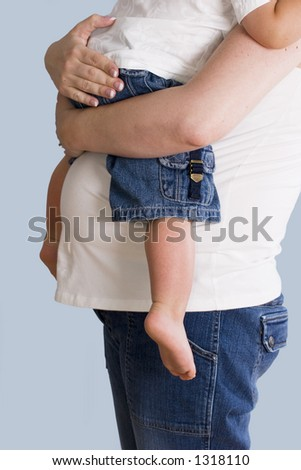 Expecting Mother  holding child - stock photo