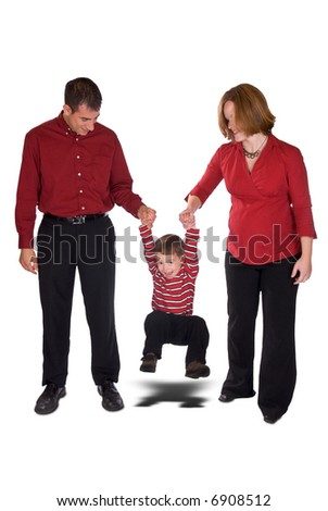 Expecting parents swinging toddler boy by his arms isolated over a white background - stock photo