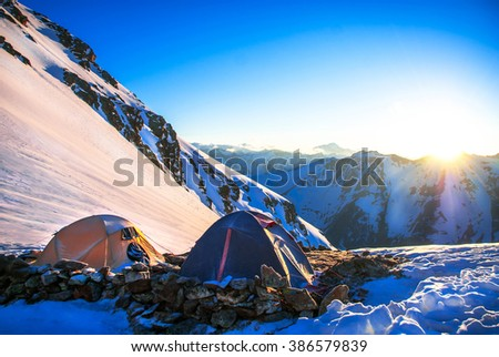 Expedition camping in tent on Mount Everest. Extreme sport concept - stock photo