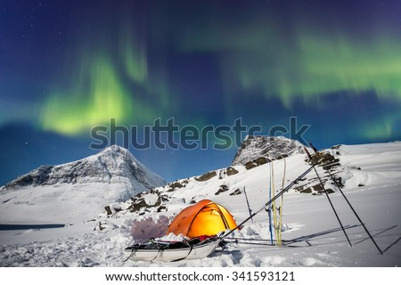 Expedition under Northern Lights in Lapland - stock photo