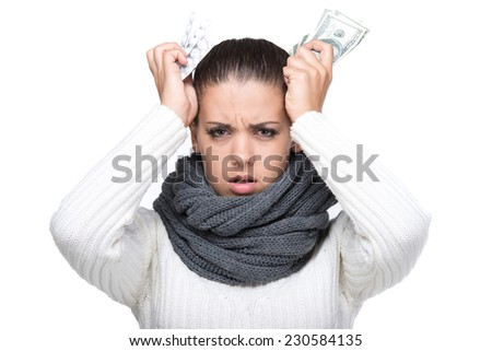 Expensive drugs. Ill woman is taking the pills and money. - stock photo