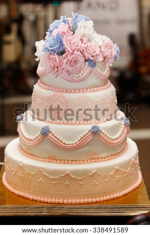 Expensive, elegant vintage wedding cake with flowers and ornaments close-up - stock photo