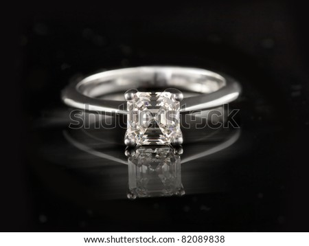 expensive engagement ring with brilliant - stock photo
