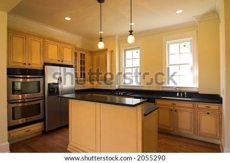 expensive kitchen with island and appliances