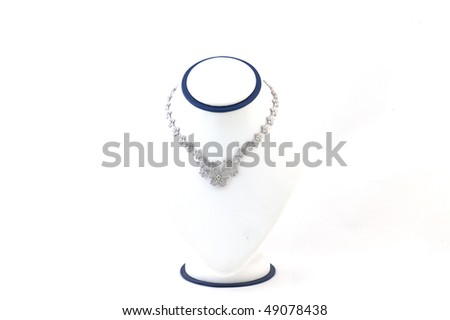 Expensive necklace presented on a stand isolated on white background