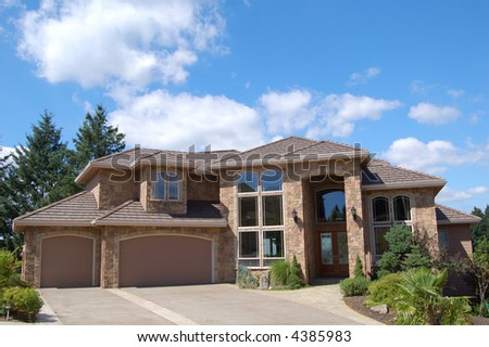 Expensive Suburban Home on Sunny Day - stock photo