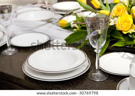 Expensive table set with yellow roses - stock photo