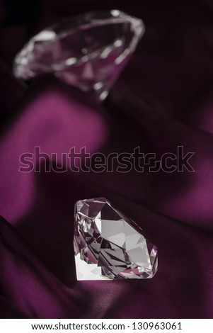 Expensive Translucent Diamonds over Purple Silk Fabric
