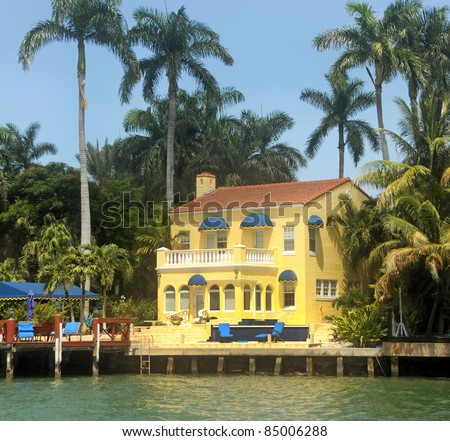 Expensive waterfront home in tropical Miami, Florida - stock photo