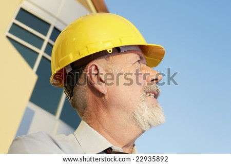 Experience engineer standing in front of an urban building