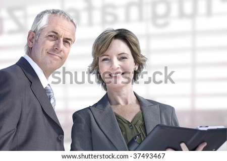 Experienced and mature business couple. - stock photo