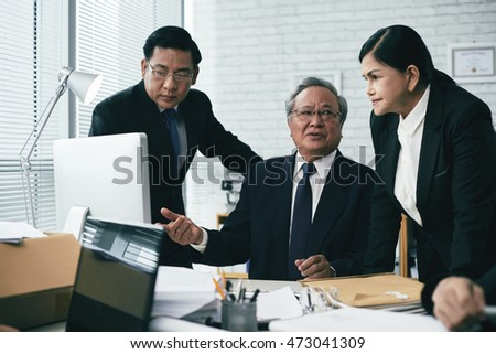 Experienced Asian team talking about legal case