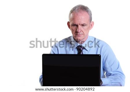 Experienced businessman concentrating on his laptop - stock photo