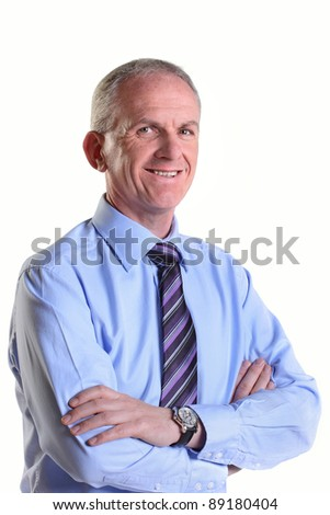 Experienced businessman smiling and looking happy - stock photo