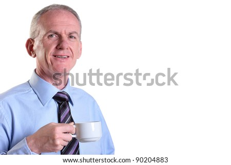 Experienced businessman taking time out with a coffee - stock photo