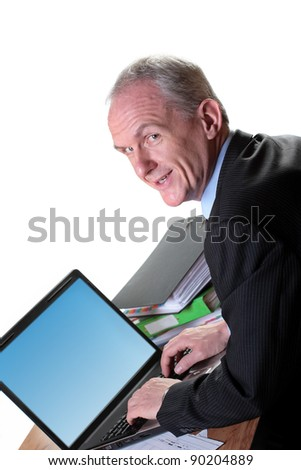 Experienced businessman with his laptop - stock photo