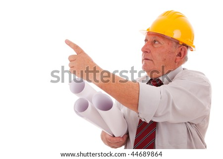 Experienced engineer holding some blueprints and pointing to the copy space  (isolated on white) - stock photo
