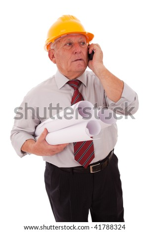 Experienced engineer talking on the phone (isolated on white) - stock photo