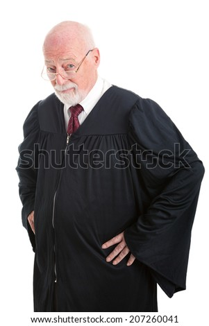 Experienced judge with serious expression.  Isolated on white.
