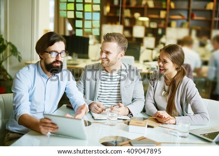 Experienced manager consulting his young colleagues  - stock photo