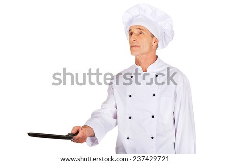 Experienced restaurant chef with frying pan - stock photo