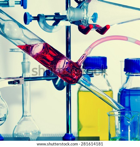 experiment in chemical laboratory. Toned photo - stock photo