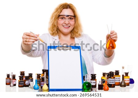 Experiment, research in progress. Chemist woman or student girl, laboratory assistant or scientific researcher with chemical glassware test flask and blank clipboard - stock photo