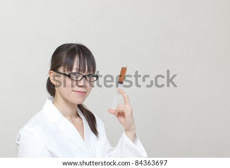 Experimenting woman - stock photo