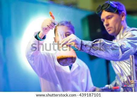 Experiments in a chemistry lab. conducting an experiment in the laboratory. - stock photo
