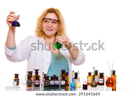 Experiments in laboratory.  Chemist woman or student girl scientific researcher with chemical bottles test flask. Isolated on white - stock photo