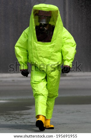expert during the surgery in an area contaminated by very dangerous biological agents - stock photo