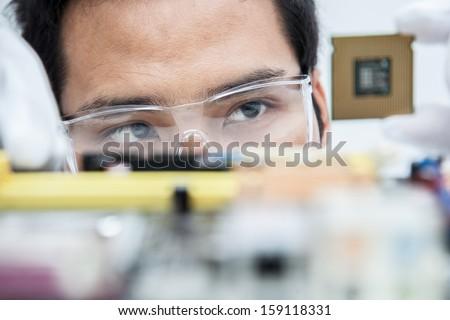 Expert engineers examining computer equipment. - stock photo